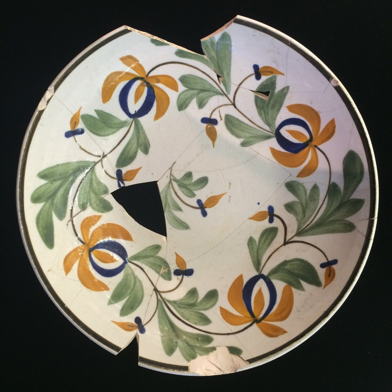 Hand-painted pearlware saucer from the Flanagan site in Mississauga.