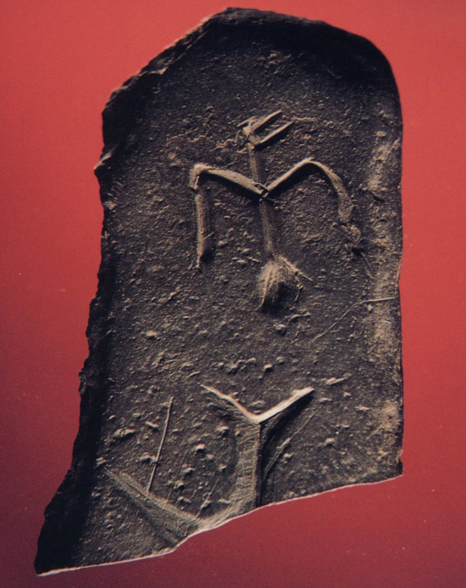 """A slate gorget bearing two inscribed """"thunderbirds."""""""