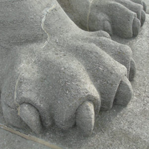 Lion Monument paws show cracks in the stone built heritage commemoration